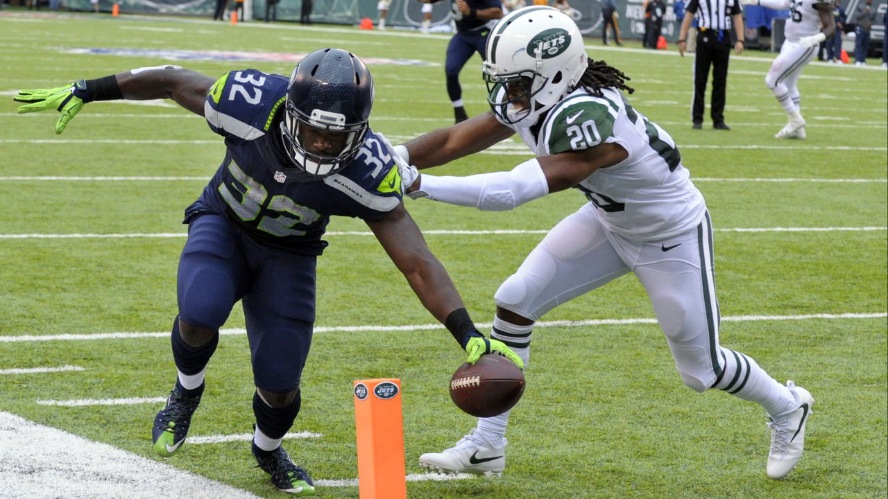 Seattle Seahawks running back Christine Michael (32) scores a touchdown as Seattle Seahawks cornerback Jeremy Lane (20) attempts to force him out of bounds during the second half of an NFL football game, Sunday, Oct. 2, 2016, in East Rutherford, N.J. (AP Photo/Bill Kostroun)