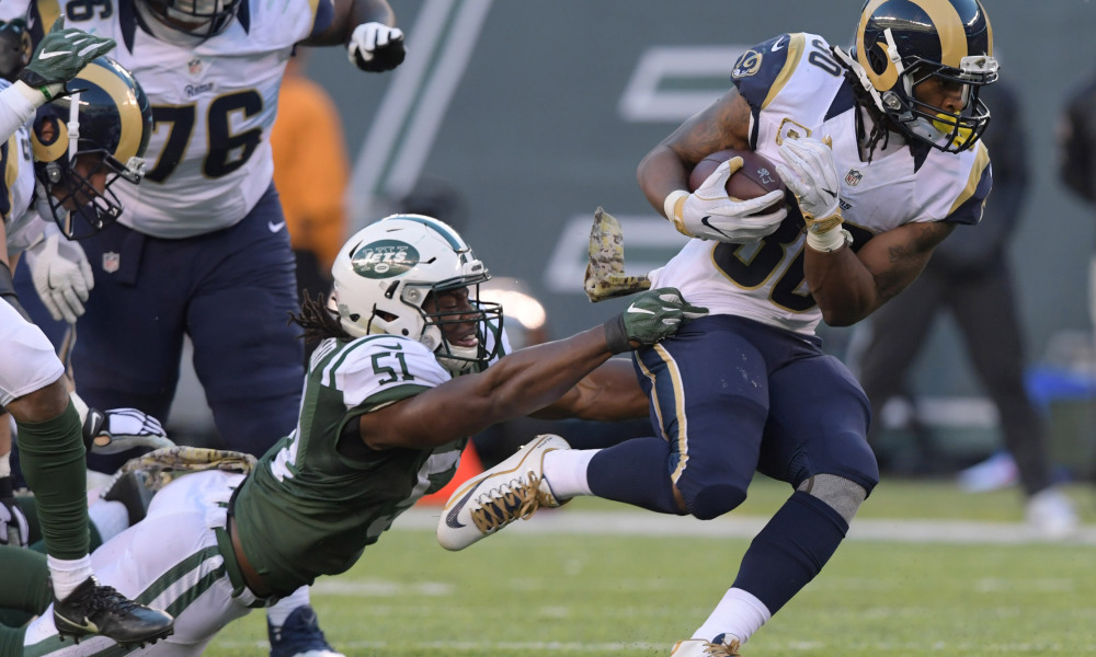 Nov 13, 2016; East Rutherford, NJ, USA; Los Angeles Rams running back Todd Gurley (30) is defended by New York Jets linebacker Julian Stanford (51) in the second half at MetLife Stadium. The Rams defeated the Jets 9-6. Mandatory Credit: Kirby Lee-USA TODAY Sports