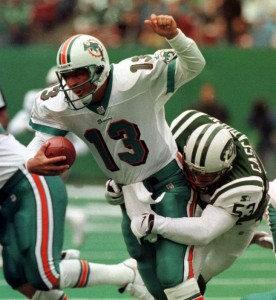 Jets linebacker Chad Cascadden wraps up Miami's Dan Marino for a sack.