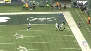 Smith's errant pass allows Revis to gain ground on Harivn as the overthrown pass falls to the turf.