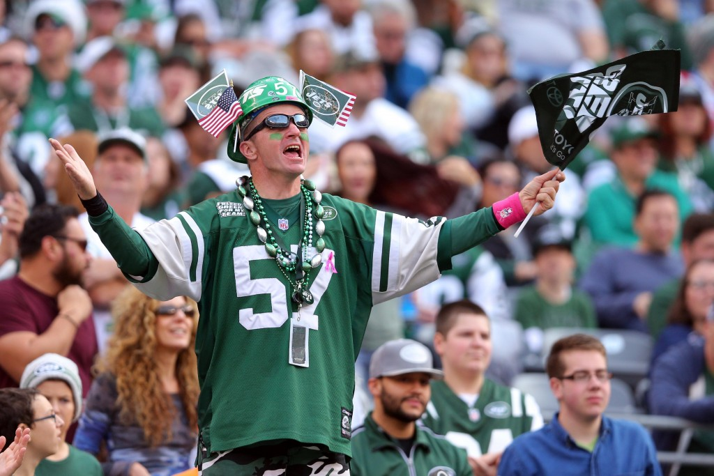 Dec 13, 2015; East Rutherford, NJ, USA; A New York Jets fan cheers during the second quarter against the Tennessee Titans at MetLife Stadium. Mandatory Credit: Brad Penner-USA TODAY Sports